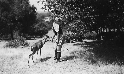Pat Gasser with a tame fawn at the ranch.